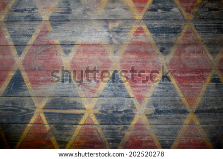 Painted pattern of rhomb on wooden floor - stock photo