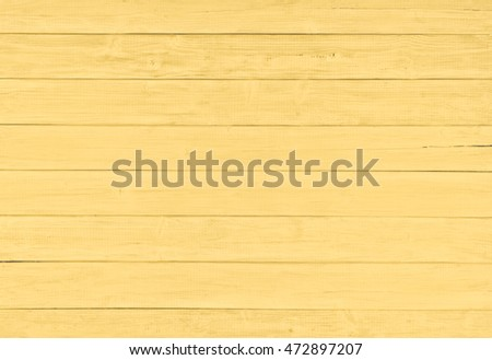 Painted Plain Soft Golden Yellow Rustic Wood Board Background that can be horizontal or vertical, with Blank Room or Space area for copy, text, your words, above looking down view. Tinted photo.