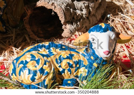 Painted pottery statue portraying a sheep in a ceramic nativity scene of an artisan in Caltagirone - stock photo