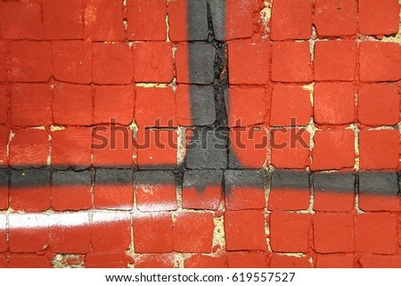 Painted red, pink and purple mosaic brick tile wall, close up of graffiti texture, with vibrant colors for creativity, imaginative backgrounds and ideas.
