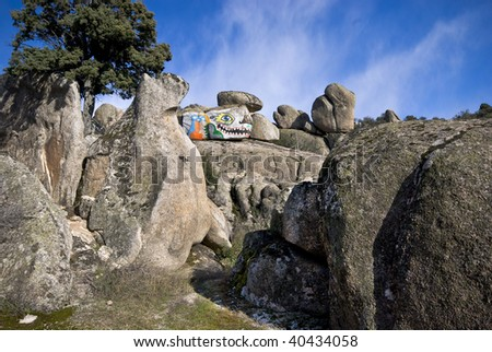 Painted rock in the central mountains of Spain.