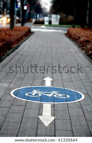 painted sign for bikes, scenic cycle track - stock photo