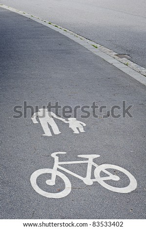Painted signs on asphalt for pedestrian and bicycle dedicated lane