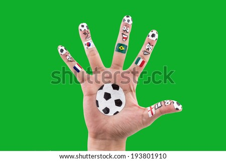 Painted soccer in different country on hand.  - stock photo