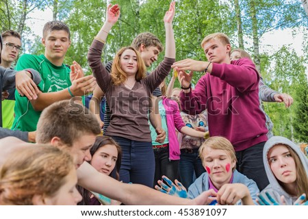 Painted teenagers froze in poses. Editorial.  Russia. Yaroslavl region. 08.07.2016