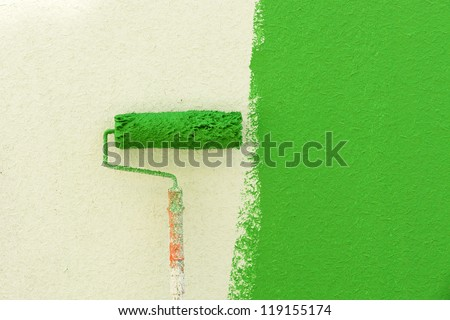 Painted walls and roller. - stock photo