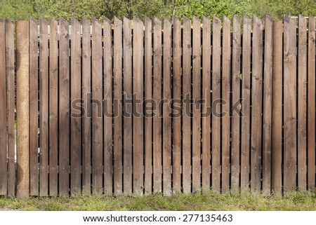 painted weathered wood planks make a nice garden fence