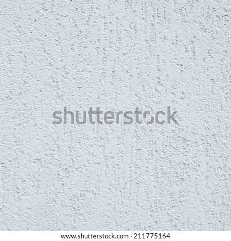 Painted white cement wall fragment as an abstract background composition - stock photo
