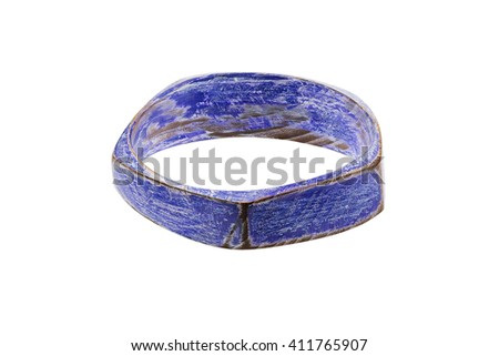 Painted wooden bracelet. Colorful, distressed, handcrafted bangle. Isolated on a white background stock photo.