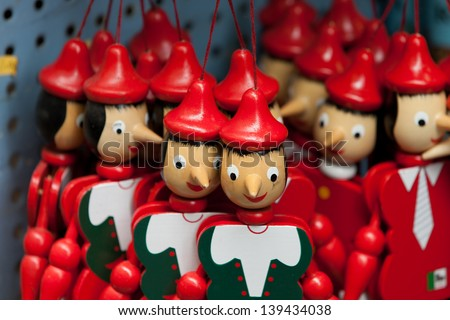 Painted wooden marionette dolls of the figure of Pinocchio - stock photo