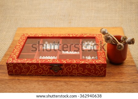 Painted, wooden small boxes for multiple purposes and white pearls