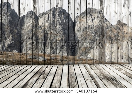 Painted wooden wall with old wooden floors. Unusual mountain landscape painted on a wooden wall. - stock photo