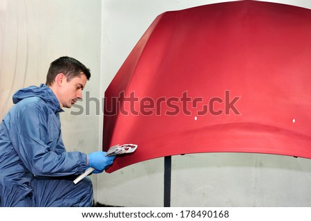 Painter compare the effect of paint. - stock photo
