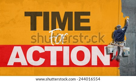 Painter hanging from harness painting a wall with the words time for action - stock photo