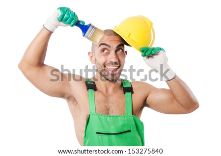 Painter in green coveralls on white - stock photo