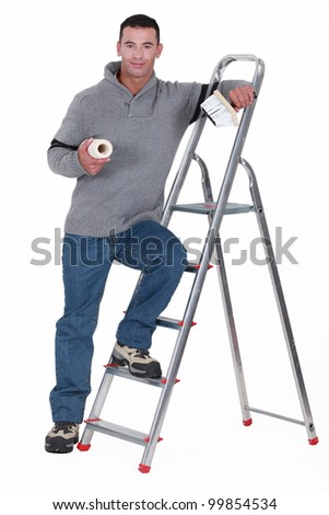 Painter resting on a stepladder - stock photo