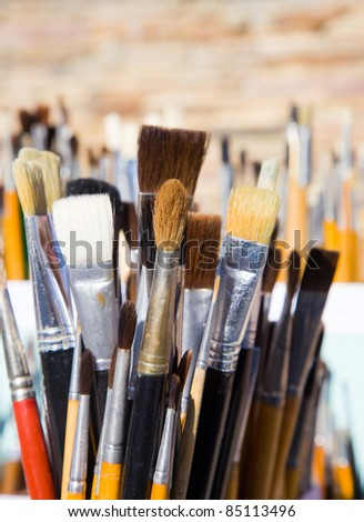 Painter's tools. Set of different art brushes. - stock photo