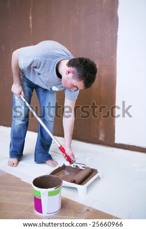 Painter using a paint roller