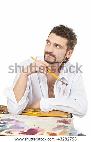 Painter with brush and palette in action. Isolated over white - stock photo