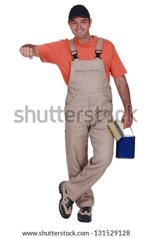 Painter with elbow resting on invisible support - stock photo