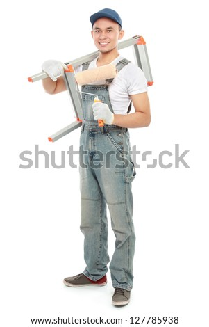 Painter with paintbrush ready to paint the wall isolated over white background - stock photo