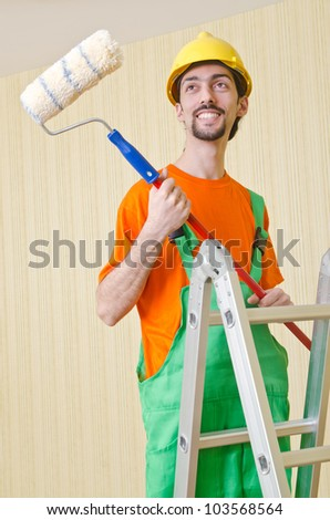 Painter worker during painting job