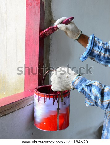 Painters are painting the windows inside buildings. - stock photo
