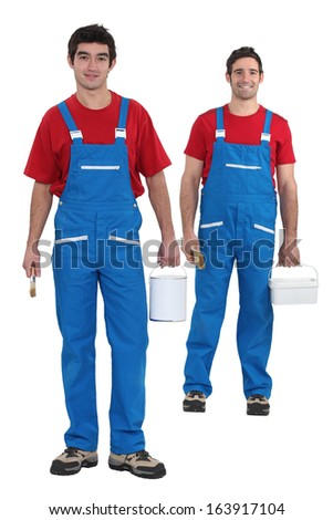 Painters with blue overalls and red-shirt - stock photo