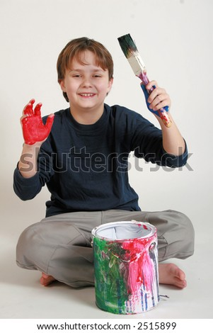 Painting a big picture with colorful hands. - stock photo