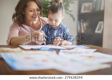 Painting a pictures with mom - stock photo