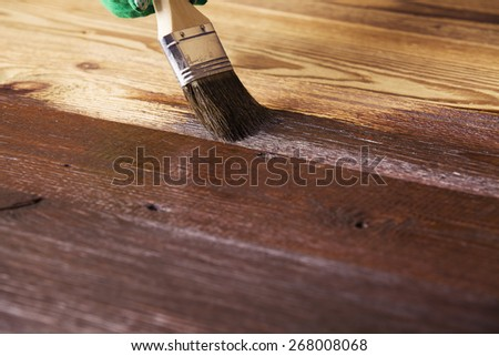 Painting and wood maintenance oil-wax - stock photo
