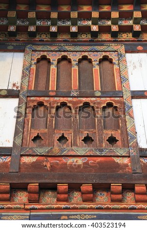 Painting and wood work at the Dzong, Bhutan
