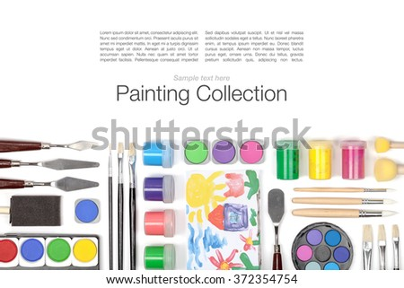 painting appliances: brushes, palette and paints on white background with copy space - stock photo