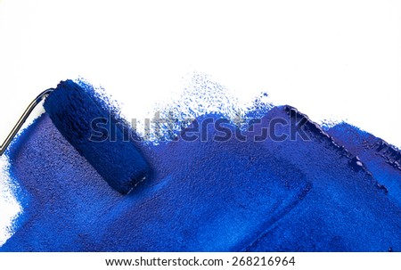painting blue with paint roller on white background - stock photo
