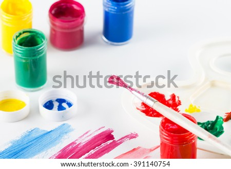 Painting brush with paint and colorful paint on white  background  - stock photo