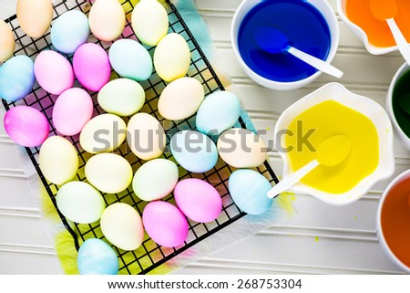 Painting eggs in pastel colors for Easter.