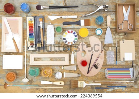 Painting equipment on a wooden table - stock photo