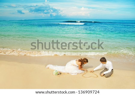 painting flower on the sand - stock photo