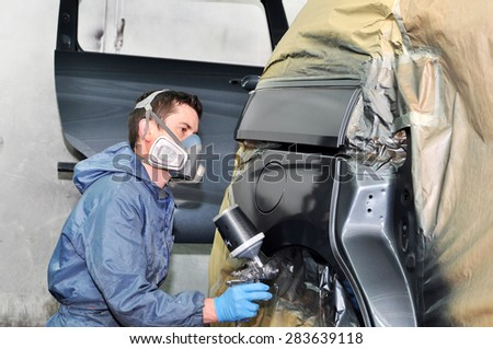 Painting gray car  by profesional. - stock photo