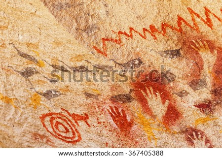 painting hands in negative and positive, guanacos and signs in the cave of the hands, prehistoric art, Patagonia, Argentina - stock photo