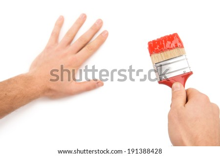 Painting house wall. Man holding painting brush isolated on white - stock photo