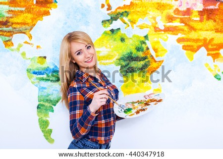 Painting is an expression of self. Portrait of an attractive young woman holding a brush and palette over - stock photo