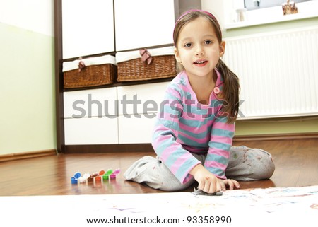 painting little girl in her room - stock photo
