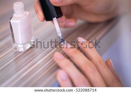 painting nails bright varnish fingers close up