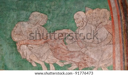 Painting of soldiers casting lots for clothing of Jesus, in twelfth-century Doppelkirche, Double Church of St. Maria and Clemens, in Schwarzrheindorf suburb of Bonn, North Rhine-Westphalia, Germany - stock photo