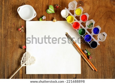 painting set - brushes, paints (gouache) on old wooden table - stock photo