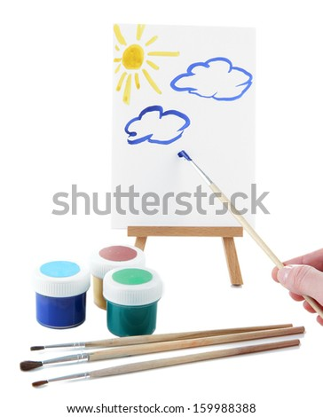 Painting supplies isolated on white - stock photo