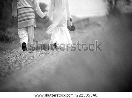 Painting the groom and bride holding hands - stock photo