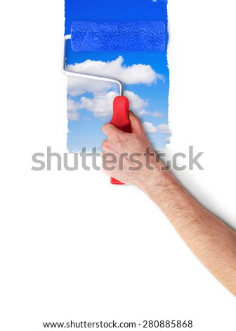 Painting the wall with sky - stock photo