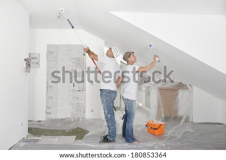 Painting the walls - stock photo
